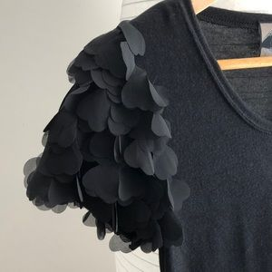 Black knit dress with petal sleeve detail